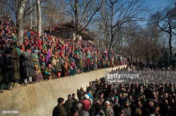 Kashmiri Muslims attend the funeral procession of one of the five militants killed in a gun battle with Indian government forces on January 16 2015...