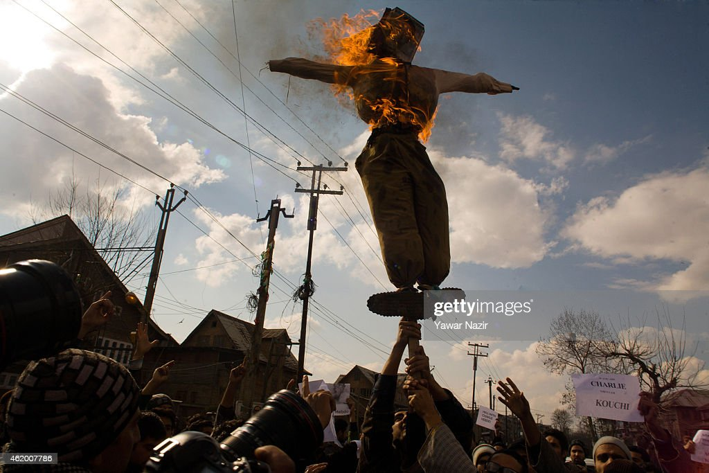 Kashmiri Muslims burn an effigy of Stephane Charbonnier, the editor of Charlie Hebdo who was killed in the attacks in Paris, during a protest against the publishing of caricatures of the Prophet Mohammed in French satirical magazine Charlie Hebdo on January 23, 2015 in Srinagar, the summer capital of Indian administered Kashmir, India. Indian authorities imposed restrictions in many parts of Srinagar and deployed large number of Indian troops on the streets of Kashmir to stop the protest called by religious and anti-India Kashmir resistance leaders against the publishing of blasphemous caricatures in French satirical magazine Charlie Hebdo.
