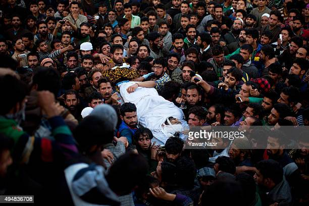 Kashmiri Muslims carry the body of Abdul Rehman alias Abu Kasim during his funeral after he was killed in a gun battle on October 29 2015 in Bugam 70...