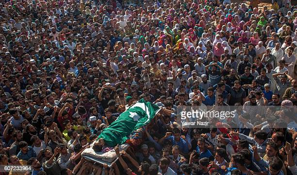 Kashmiri Muslims carry the body of Nasir Shafi 11 year old who was killed by the pellets of Indian government forces during his funeral on September...