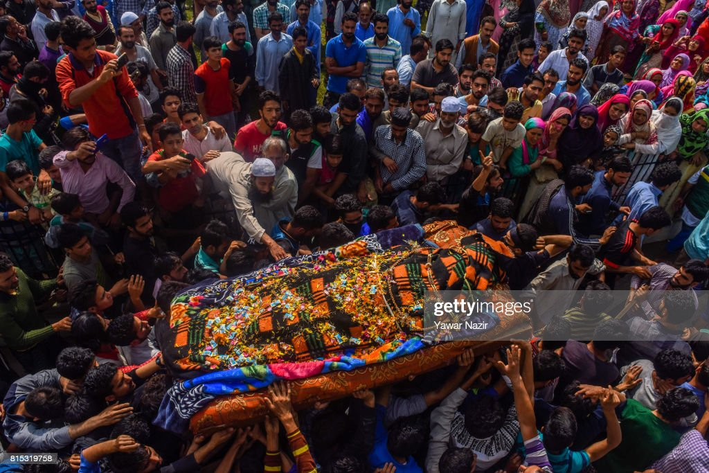 Kashmiri Muslims carry the body of Parvaiz Ahmad Mir, a local rebel killed in a gun battle with Indian government forces during his funeral on July 16, 2017 in Pohoo, 26km (16miles) south of Srinagar, the summer capital of Indian administered Kashmir, India. Thousands of mourners in Kashmir joined the funeral of the three rebels who were killed in a gunfight with government forces on Saturday. The day long gun battle started on Saturday on a hillock where the militants were taking shelter in a cave in the forest area of the Tral region in south Kashmir's Pulwom district, and ended yesterday evening. Indian government forces then launched a cordon and search operation, the militants hiding in a cave up the hill opened fire at the forces which retaliated, triggering a gun battle. Of the three militants killed in the gun battle, two were locals and had recently joined the militant outfit, and the third was a Pakistani national. The militants killed are believed to be members of Pakistan-based Jaish-e-Mohammad (JeM) militant outfit.
