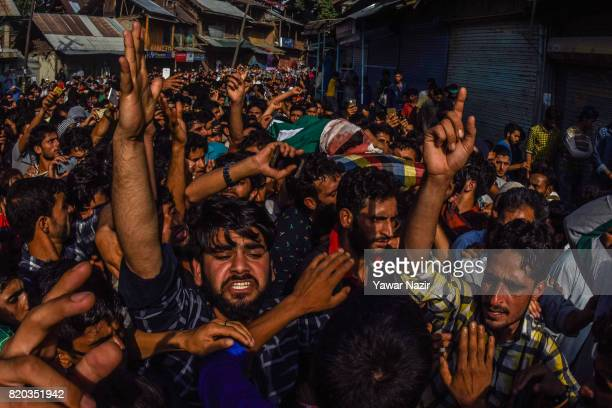 Kashmiri Muslims chant antiIndian and proKashmir freedom slogans as they carry the body of Tanveer Ahmad Pala a civilian killed by Indian military...