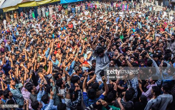 Kashmiri Muslims chant antiIndian and proKashmir freedom slogans in front the body of Tanveer Ahmad Pala a civilian killed by Indian military forces...