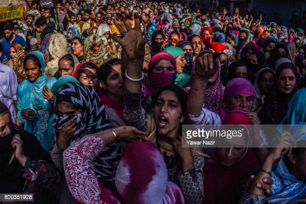 Kashmiri Muslims chant antiIndian and proKashmir freedom slogans during the funeral of Tanveer Ahmad Pala a civilian killed by Indian military forces...