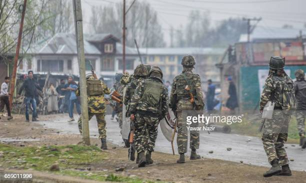 Kashmiri Muslims clash with Indian government forces as they tried to march towards gun battle site where suspected rebels are trapped and fighting...