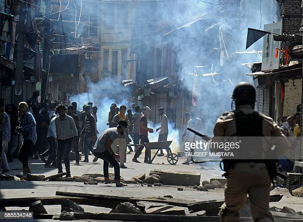 Kashmiri muslims clash with Indian security forces after the funeral of 20 yearold Kashmiri youth Riyaz Ahmed Shah in downtown Srinagar on August 3...