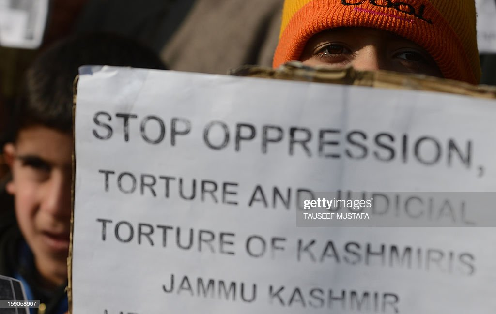 Kashmiri Muslim's hold placards during a protest against a court verdict sentencing two Kashmiris to life imprisonment in Srinagar on January 7, 2013. The Muslim-majority region is in the grip of a 20-year insurgency against rule from New Delhi, which has left more than 47,000 people dead by the official count, a separatists put the toll twice as high. AFP PHOTO/ Tauseef MUSTAFA