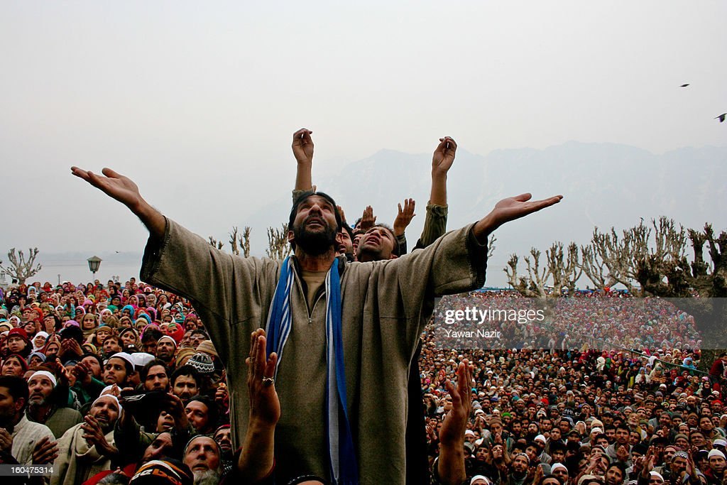 Kashmiri Muslims look towards a cleric displaying the holy relic believed to be the hair from the beard of the Prophet Mohammed at Hazratbal shrine on the Friday following Eid-e-Milad , or the birth anniversary of Prophet Mohammad on February 01, 2013 in Srinagar, the summer capital of Indian administered Kashmir, India. Thousands of Muslims from all over Kashmir visit the Hazratbal shrine in Srinagar to pay obeisance on the Friday following Eid-e-Milad , or the birth anniversary of Prophet Mohammed. The shrine is highly revered by Kashmiri Muslims as it is believed to house a holy relic of the Prophet Mohammed. The relic is displayed to the devotees on important Islamic days such as the Eid- Milad when Muslims worldwide celebrate.