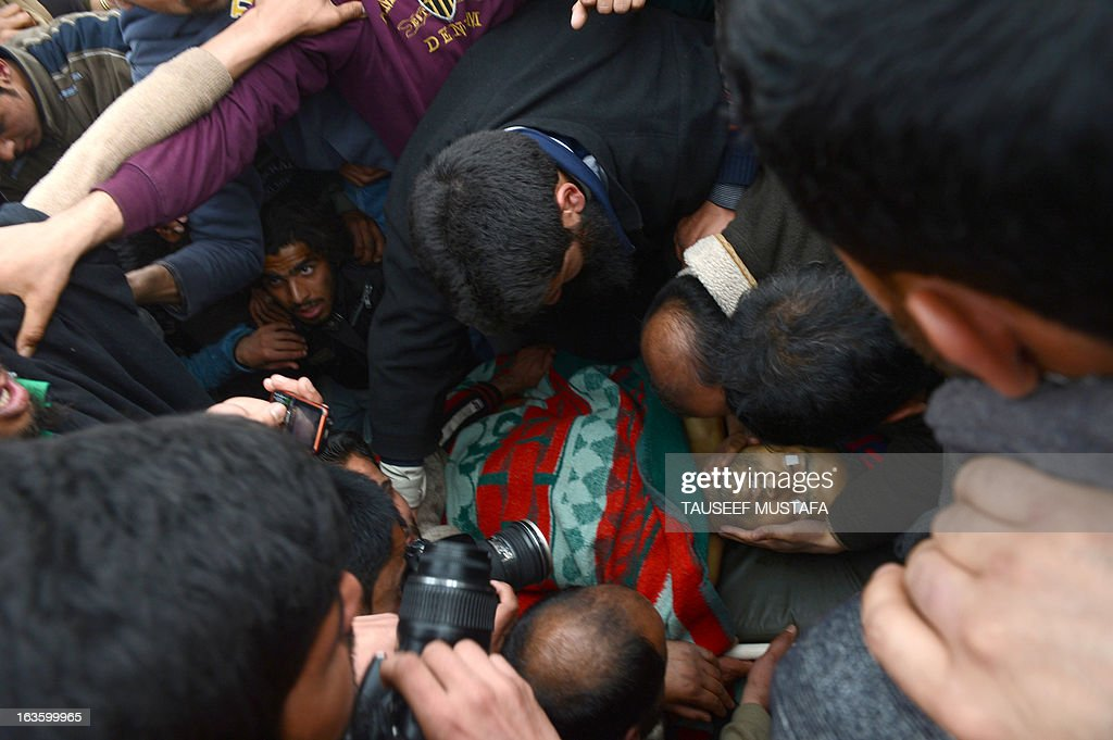 Kashmiri Muslim's mourn for Altaf Hussain Wani, 22, during a funeral procession in Srinagar on March 13, 2013. Wani died when Indian Paramilitary troopers allegedly fired at him when he was crossing the road in his neighbourhood eyewitness told AFP. Attacks in Srinagar have become rare in recent years with violence across the region at its lowest level since the insurgency began in 1989, boosting the vital local tourism industry. AFP PHOTO/ Tauseef MUSTAFA