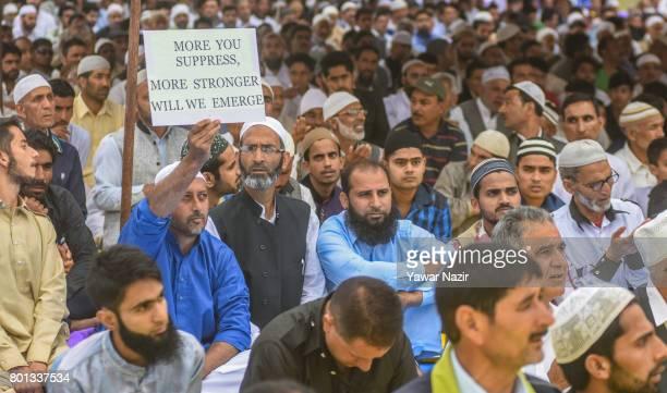 Kashmiri Muslims offer congregational EidulFitr prayers at Eid Gah on Eidulfitr a festival of Muslims on June 26 2017 in Srinagar the summer capital...