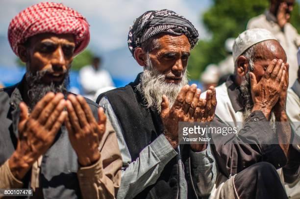 Kashmiri Muslims offer prayers at Hazratbal shrine on the last Friday of the holy Islamic month of Ramadan on June 23 2017 in Srinagar the summer...