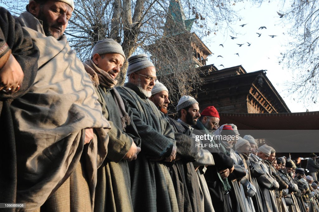 Kashmiri Muslims offer prayers at the shrine of Sufi saint Naqashband Sahib during an annual festival in downtown Srinagar on January 16, 2013. Thousands of people gathered to offer prayers marking the birth anniversary of Sufi saint Naqashband Sahib at his shrine in Srinagar. AFP PHOTO/ Rouf BHAT