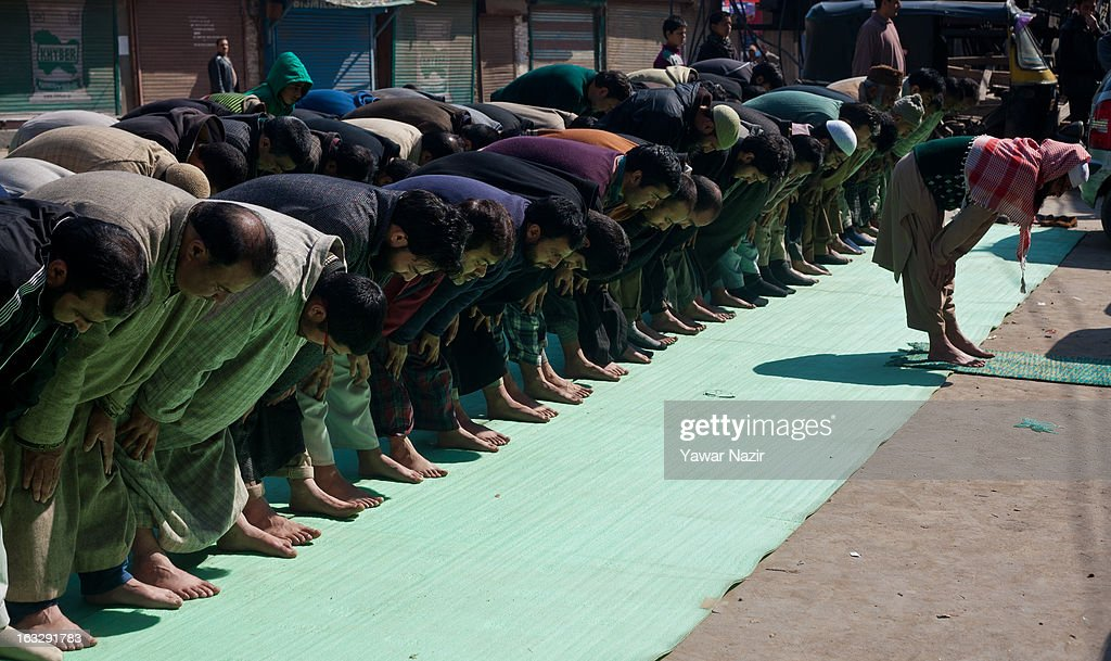 Kashmiri Muslims offer prayers on a road as a mark of protest during a curfew-like restriction on March 7, 2013 in Srinagar, the summer capital of Indian Administered Kashmir, India. Clashes erupted in most parts of Kashmir today leaving scores of people injured. Meanwhile Indian authorities imposed curfew-like restrictions for the second consecutive day in most parts of Kashmir following the killing of a Kashmiri youth by the Indian army in North Kashmir's Baramulla district.