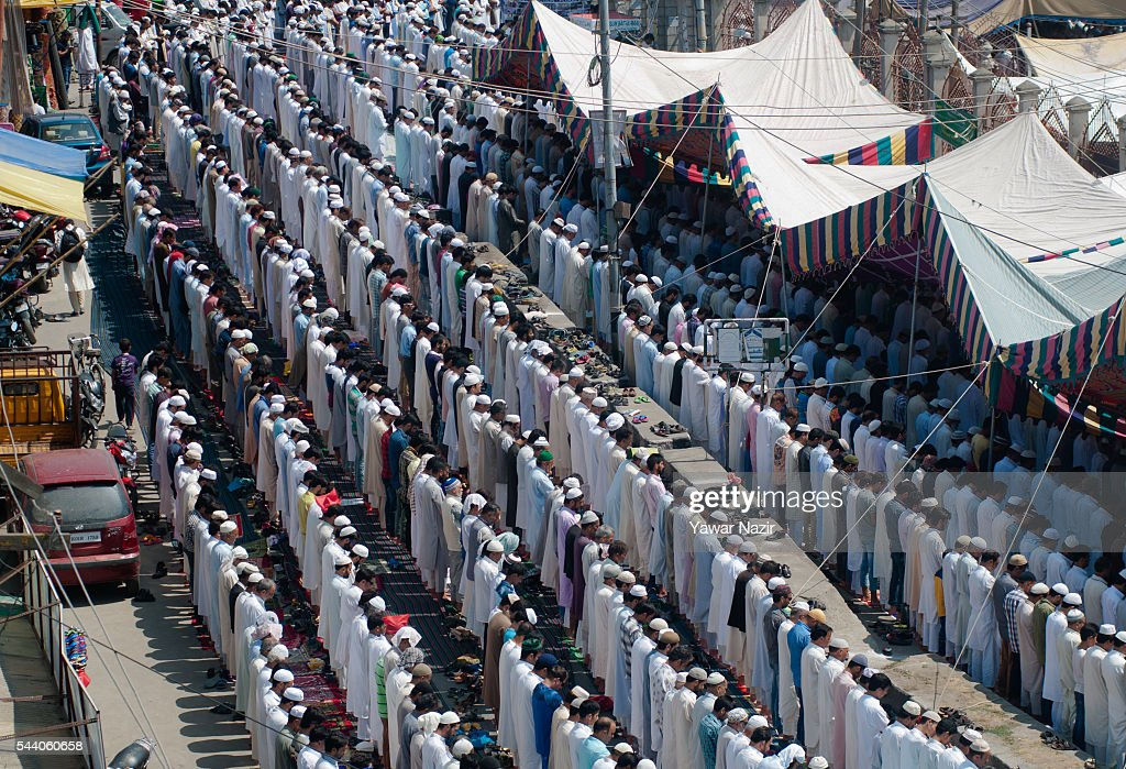 Kashmiri Muslims offer prayers outside the Grand Mosque on the last Friday of the holy Islamic month of Ramadan on July 01, 2016 in Srinagar, the summer capital of Indian administered Kashmir, India. Hundreds of thousands of Kashmiri Muslim devotees took part in the mass prayer of the last Friday, or Jummat-ul-Vida, of the holy Islamic month of Ramadan ahead of the Eid al-Fitr festival which marks the end of the fasting month of Ramadan.