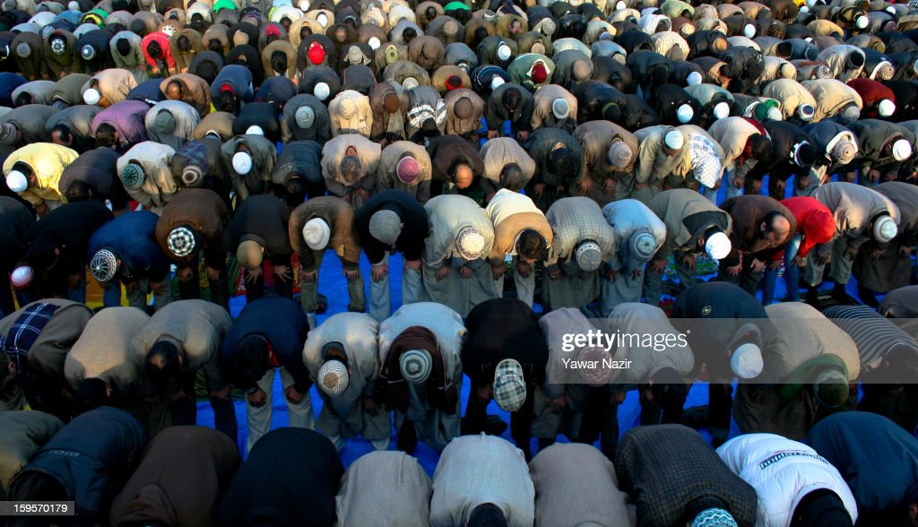 Kashmiri Muslims offer prayers outside the shrine of Khwaja Naqshband on January 16, 2013 in Srinagar, the summer capital of Indian-administered Kashmir, India. Thousands of devotees from across Kashmir converge at the shrine of Khwaja Naqshband Sahib in downtown Srinagar to participate in annual congregational prayers called 'Khoja Digar' on the 3rd of Rabi-ul-Awal, the third month of the Islamic calendar.