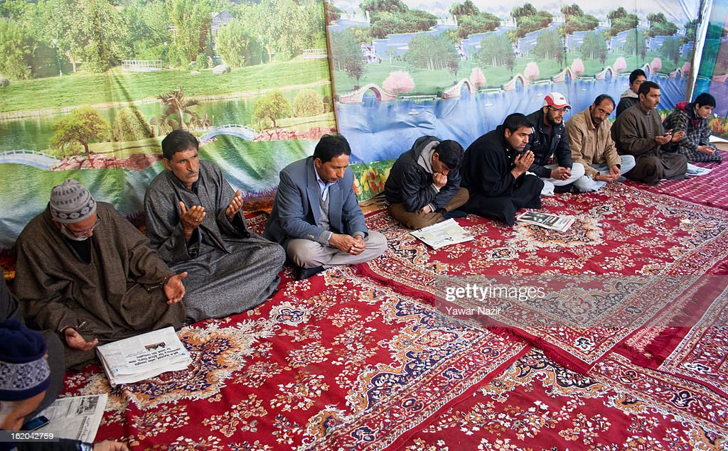 Kashmiri Muslims offer special prayers for , executed Kashmiri separatist Mohammad Afzal Guru, at his residence on February 18, 2013 in Jagir, Sopore, 50 km (31 miles) north of Srinagar, the summer capital of Indian-administered Kashmir, India. Guru was secretly hanged and buried at the Tihar Jail in India's capital, New Delhi, on February 9 for his alleged role in the 2001 attack on the country's Parliament. His family alleges that they were kept in dark about the execution by the Indian government . Apprehensive of a massive public fallout over the execution, Indian authorities clamped a curfew for seven consecutive days in Kashmir even as three people were killed allegedly in Indian government forces' action during protests and clashes . Meanwhile, separatist groups have called for a three day strike beginning Wednesday to press the Indian government for handing over of Guru's mortal remains to his family for his last rites, a demand growing louder by the day in Kashmir.