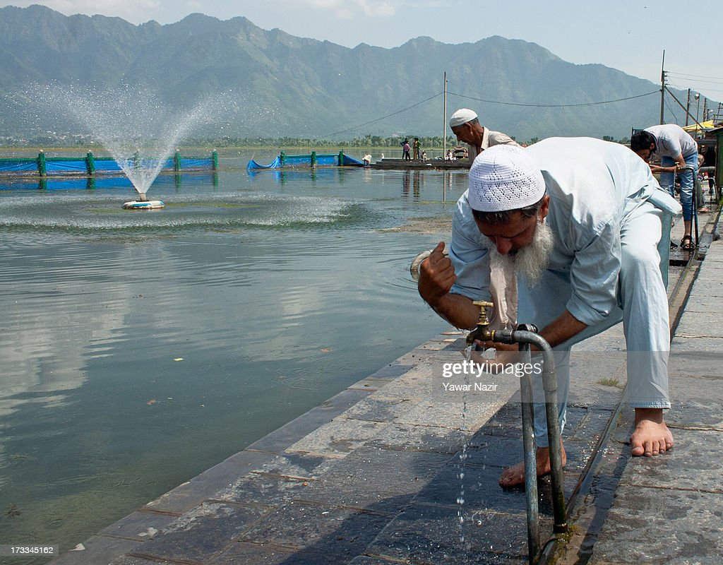Kashmiri Muslims perform ablution on the bank of Dal lake before offering prayers on the first Friday of holy month of Ramadan on July 12, 2013 in Srinagar, the summer capital of Indian administered Kashmir, India. Ramadan is the ninth month of Islamic lunar calendar, during which Muslims believe the Quran was given to Prophet Muhammad. Muslims across the globe refrain from eating, drinking and sex from dawn to dusk during the month. Besides spending more time praying, donating alms is mandatory. Every Muslim has to give 2.5 per cent of their wealth and assets, in excess of what is required, to the poor.
