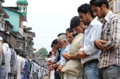Kashmiri Muslims perform congregational prayers on a street during the first day of the fasting month of Ramadan in Srinagar on July 21 2012 Muslims...