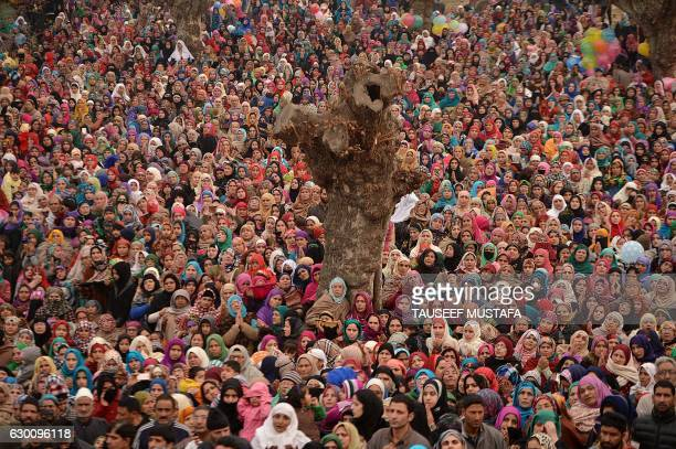 Kashmiri Muslims pray as a custodian displays a relic believed to be a hair from the beard of Prophet Mohammed on the last Friday of celebrations...