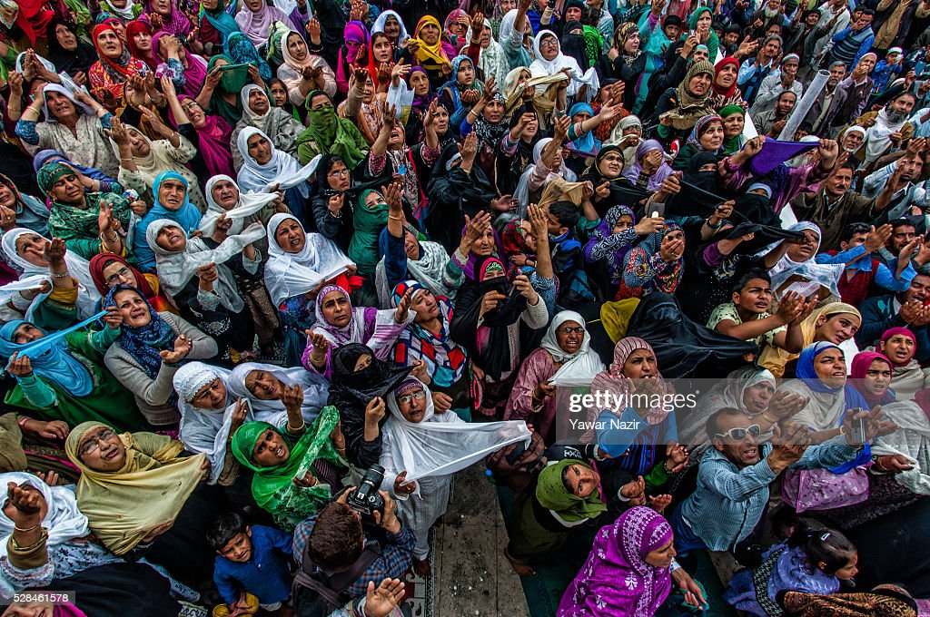 Kashmiri Muslims pray as a head priest displays the holy relic believed to be the whisker from the beard of the Prophet Mohammed on the occasion of...