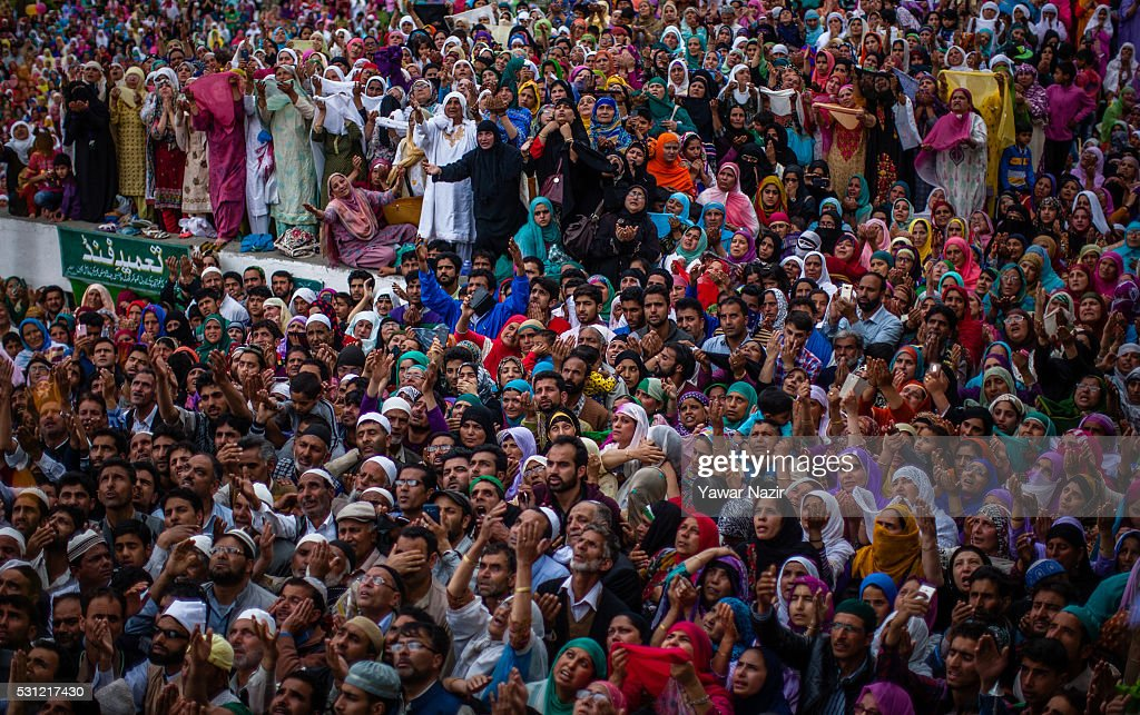 Kashmiri Muslims pray as a head priest displays the holy relic believed to be the whisker from the beard of the Prophet Mohammed at the Hazratbal...