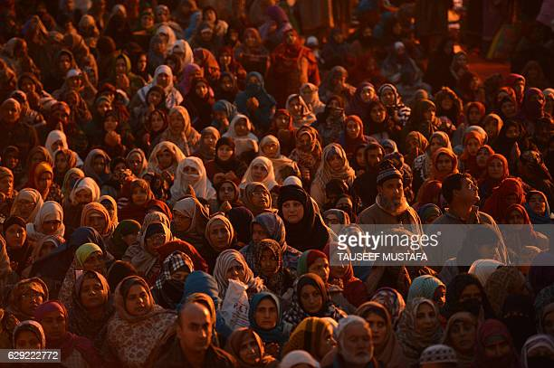 TOPSHOT Kashmiri Muslims pray as a priest displays a relic believed to be a hair from the beard of Prophet Muhammed during EideMiladunNabi the...