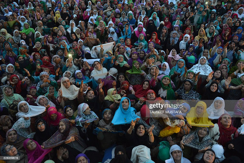 Kashmiri Muslims pray as an unseen custodian displays a holy relic, believed to be a hair from the Prophet Muhammad's beard, during celebrations for Miraj-Ul-Alam (ascension to heaven) at Kashmir's main Hazratbal Shrine in Srinagar on May 5, 2016. Thousands of Muslims converge annually for celebrations at the shrine near the summer capital of the state of Jammu and Kashmir. / AFP / TAUSEEF