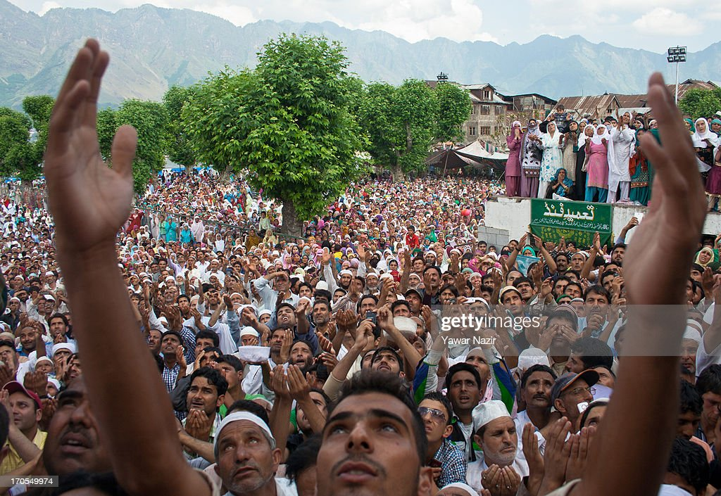 Kashmiri Muslims pray as they watch a head priest displays a holy relic believed to be the hair from the beard of the Prophet Mohammed during the last Friday on the occasion of the Muslim festival Mehraj-u-Alam at the Hazratbal Shrine on June 14, 2013 in Srinagar, the summer capital of Indian administered Kashmir, India. Mehraj-u-Alam marks the night Muslims believe Prophet Mohammed ascended to the heaven. Every year thousands of devotees from across Kashmir throng the Hazratbal shrine for prayers and glimpse the Moi-e-Muqaddas, a Holy Relic of Prophet Mohammed, that is displayed for public viewing on ten occasions in a year.