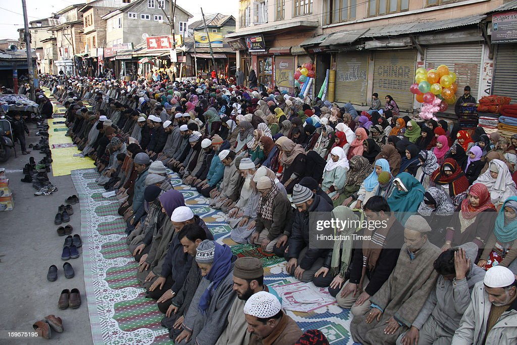Kashmiri muslims pray outside the shrine of Sufi saint Naqashband Sahib, on January 16, 2013 in Srinagar, India. Thousands of People gathered to offer prayers marking the birth anniversary of the Sufi saint Naqashband Sahib at his shrine.