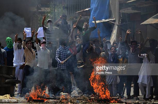 Kashmiri Muslims shout anti India slogans during a protest against the killing of civilians by Indian police Indian police on Friday shot dead...