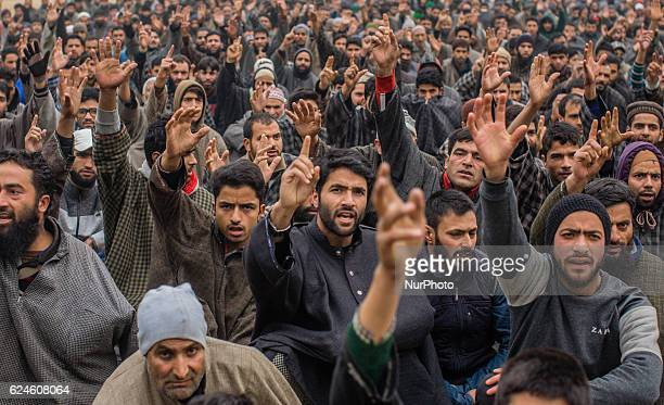 Kashmiri Muslims shout anti Indian and Pro Kashmir freedom slogans as they attend the funeral of Rayees Ahmad a militant who was killed in a gun...