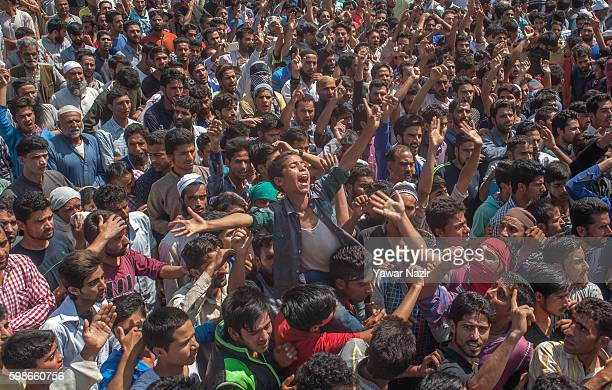 Kashmiri Muslims shout anti Indian and pro Kashmir freedom slogans during the funeral of Danish of Danish Haroo a 12 year old boy who died when he...