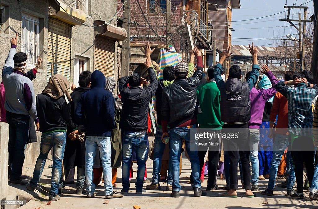 Kashmiri Muslims shout anti-Indian and pro-freedom slogans during a curfew-like restriction on March 7, 2013 in Srinagar, the summer capital of Indian Administered Kashmir, India. Clashes erupted in most parts of Kashmir today leaving scores of people injured. Meanwhile Indian authorities imposed curfew-like restrictions for the second consecutive day in most parts of Kashmir following the killing of a Kashmiri youth by the Indian army in North Kashmir's Baramulla district.