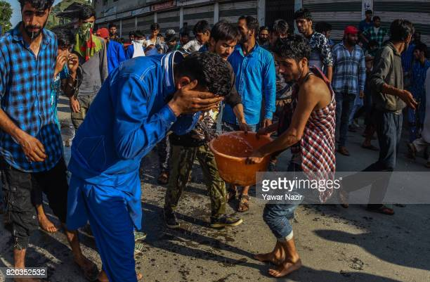 Kashmiri Muslims was their face after they were tear gassed by Indian government forces while carrying the body of Tanveer Ahmad Pala a civilian...