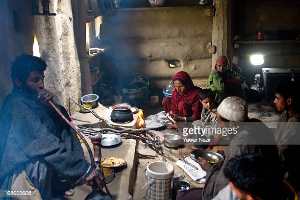 Kashmiri nomad family sit inside their mudhut in Doodhpathri Valley on May 12 50 kms west of Srinagar the summer capital of Indian administered...