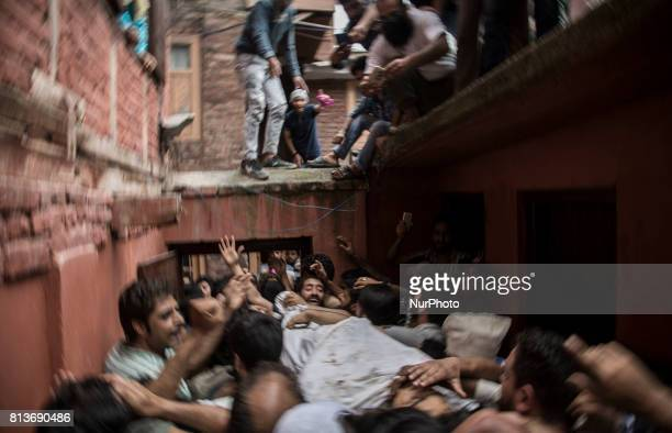 Kashmiri people carry the body of a local rebel Sajad Gilkar during his funeral Wednesday July 12 2017 in Srinagar Indianadministered Kashmir India...