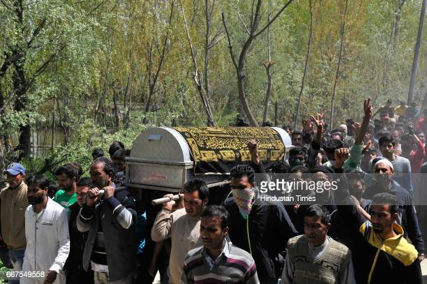 Kashmiri people carry the coffin of Ali Mohammad Dagga a driver who was on election duty died when his vehicle came under attack of stone pelters on...