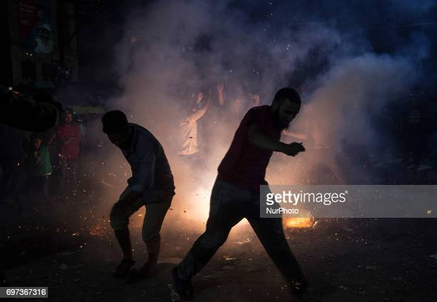 Kashmiri people celebrate after Pakistan's win in the ICC Champions Trophy final cricket match against India Sunday June 18 in the old city of...
