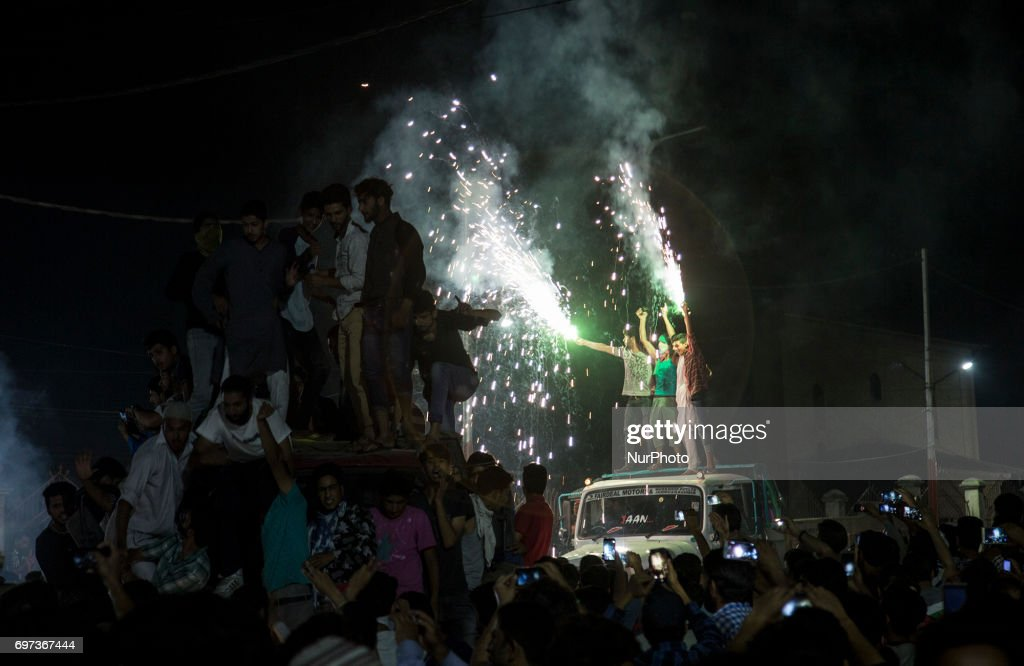 Kashmiri people celebrate after Pakistan's win in the ICC Champions Trophy final cricket match against India Sunday, June 18, 2017, in the old city of Srinagar, Indian-administered Kashmir. Pakistan thrashed title-holders India by 180 runs to win the Champions Trophy final at The Oval in London on June 18, 2017.