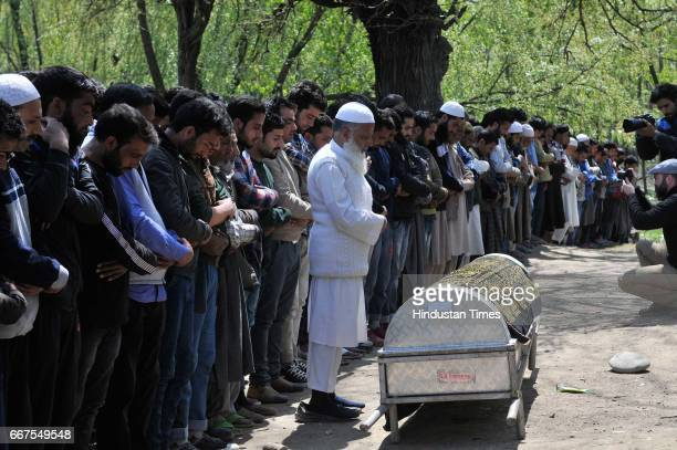 Kashmiri people offer the funeral prayers of Ali Mohammad Dagga a driver who was on election duty died when his vehicle came under attack of stone...