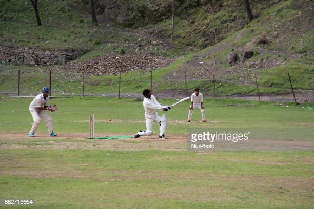 Kashmiri Players Playing a cricket match in a local ground at Baramulla
