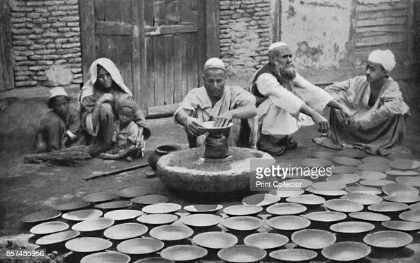 Kashmiri potters at work 1902 From The Living Races of Mankind Vol I [Hutchinson Co London 1902] Artist Bourne Shepherd