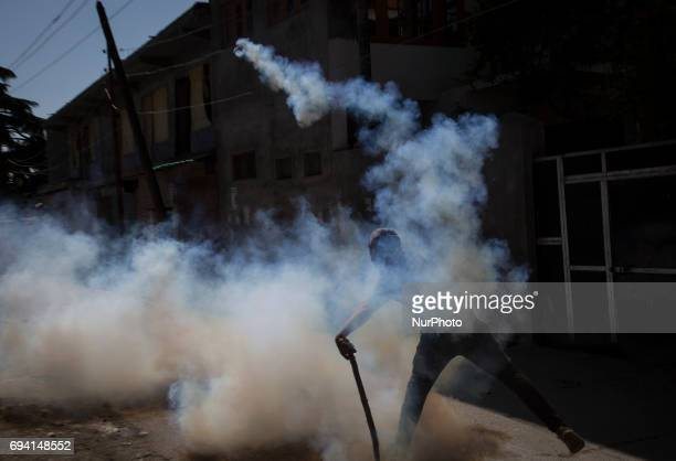 A Kashmiri protester throws an exploded tear gas shell back at Indian police men during a protest Friday June 9 in Srinagar Indianadministered...