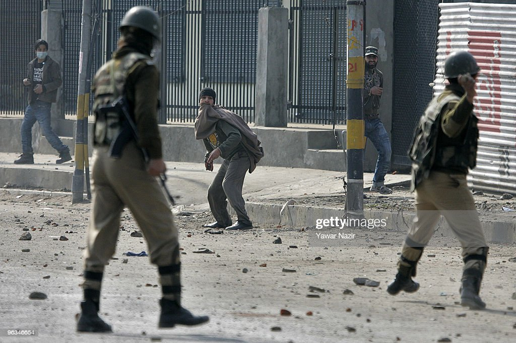 Kashmiri protesters and Indian police officers throw stones at each other during a protest against the death of a 14 year-old Wamiq Farooq on February 02, 2010 in Srinagar, India. Indian police and Muslim protesters clashed for the second consecutive day against the killing of Farooq, hurling stones at Indian police in many parts of Kashmir and in retaliation Indian police fired teargas and live rounds to disperse scores of Kashmiris. Farooq was allegedly shot in the head and hit by a tear gas shell fired by Indian police during a clash between the police and Kashmiri protesters on Sunday evening. Farooq later died from his injuries at a hospital.