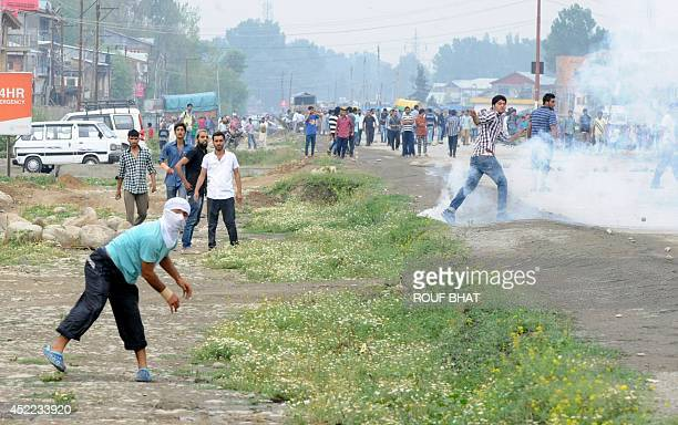 Kashmiri protesters clash with Indian police in the outskirts of Srinagar on July 162014 Six people were killed and two others injured in a headon...