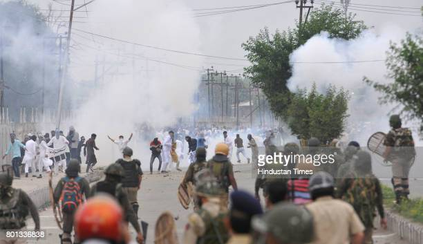 Kashmiri protesters clash with police and paramilitary soldiers after EidUlFitr prayers at Eidgah on June 26 2017 in Srinagar India Eid prayers in...