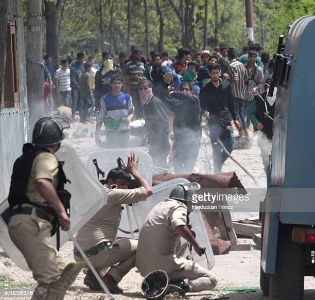 Kashmiri protesters hurl rocks and bricks at policemen during a protest against killing of a teenage student Suhail Ahmed Sofi at Narbal some 15...