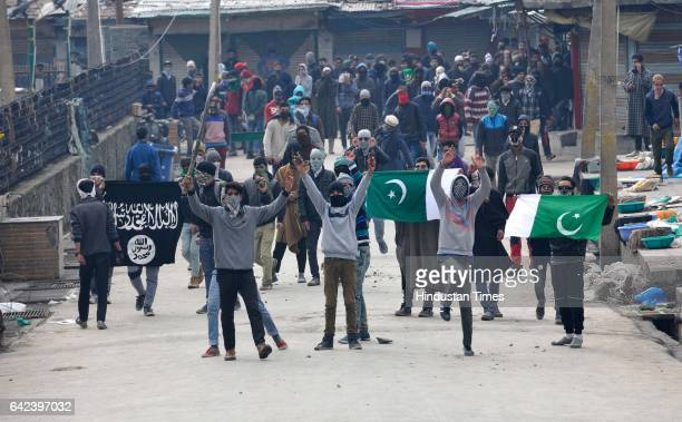 Kashmiri protesters shout slogan as they carry Pakistani's flag during the protest after Friday Prayers on February 17 2017 in Srinagar India