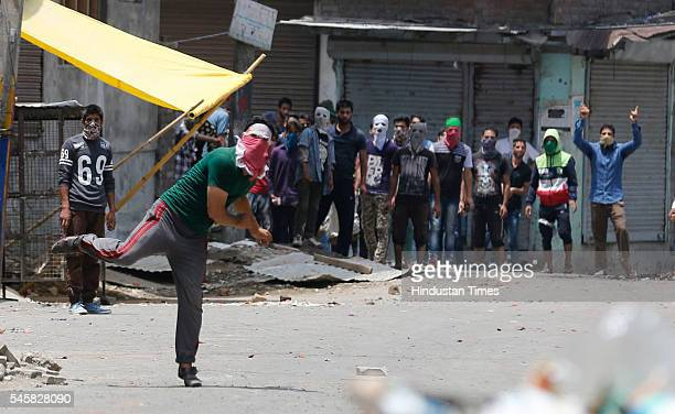 Kashmiri protesters throw stones at police during clashes on July 10 2016 in Srinagar India Clashes continued in Kashmir for the third day against...