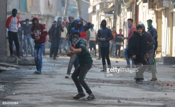 Kashmiri protesters throw stones during clashes with Indian police and paramilitary personnel in Srinagar on February 10 2017 Indian forces fired...
